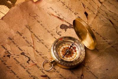 Compasses and ancient manuscripts - backgrounds