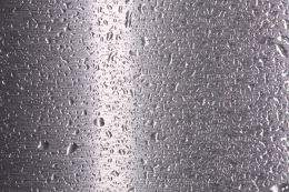 Texture of gray metal with drops of water